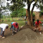 The Water Project: Malaha Primary School -  Community Members Helping Mix Cement