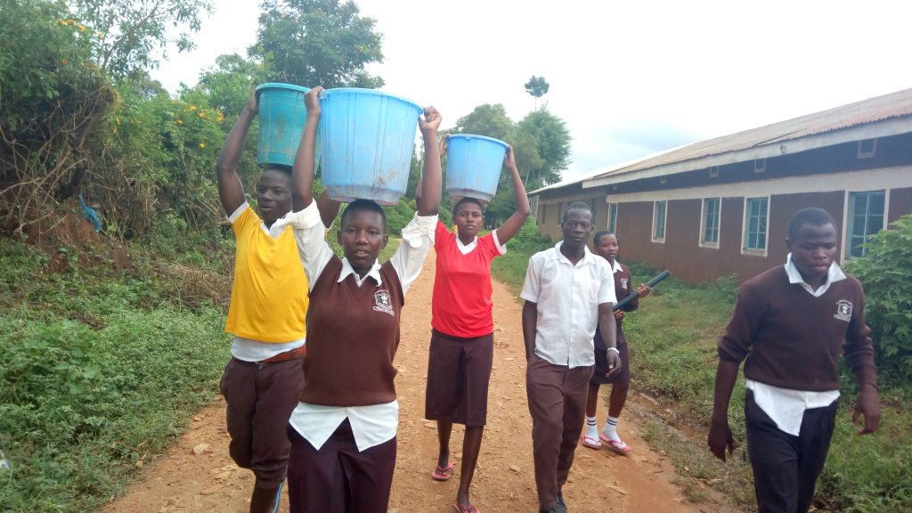 The Water Project : 10-kenya4837-carrying-water-back