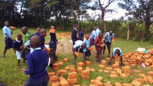 The Water Project:  Students Carrying Bricks