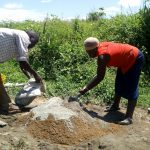 The Water Project: Shivagala Community, Paul Chengoli Spring -  Mixing Concrete