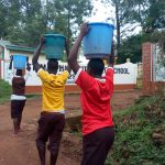 The Water Project: Mwitoti Secondary School -  Carrying Water Back