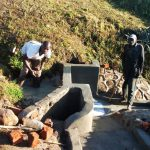 The Water Project: Shivagala Community, Paul Chengoli Spring -  Backfilling The Spring