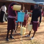 The Water Project: Irenji Primary School -  Students Refilling The Hand Washing Station