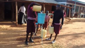 The Water Project:  Students Refilling The Hand Washing Station
