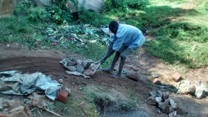 The Water Project:  Man Delivering Stones To The Spring