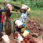 The Water Project: Lugango Community -  Women Carrying Construction Materials