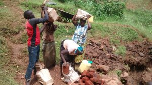 The Water Project:  Women Carrying Construction Materials