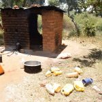 The Water Project: Kivani Primary School -  Kitchen And Water Containers