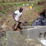 The Water Project: Shivagala Community, Paul Chengoli Spring -  Backfilling