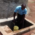 The Water Project: Friends Emanda Secondary School -  Edwin Mwelesa Fetching Clean Water At The Tank