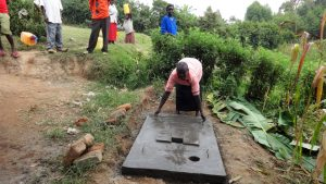 The Water Project:  Woman Demonstrating How To Clean A Sanitation Platform