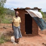 The Water Project: Nzalae Community -  Tabitha Munywoki At Her Latrine