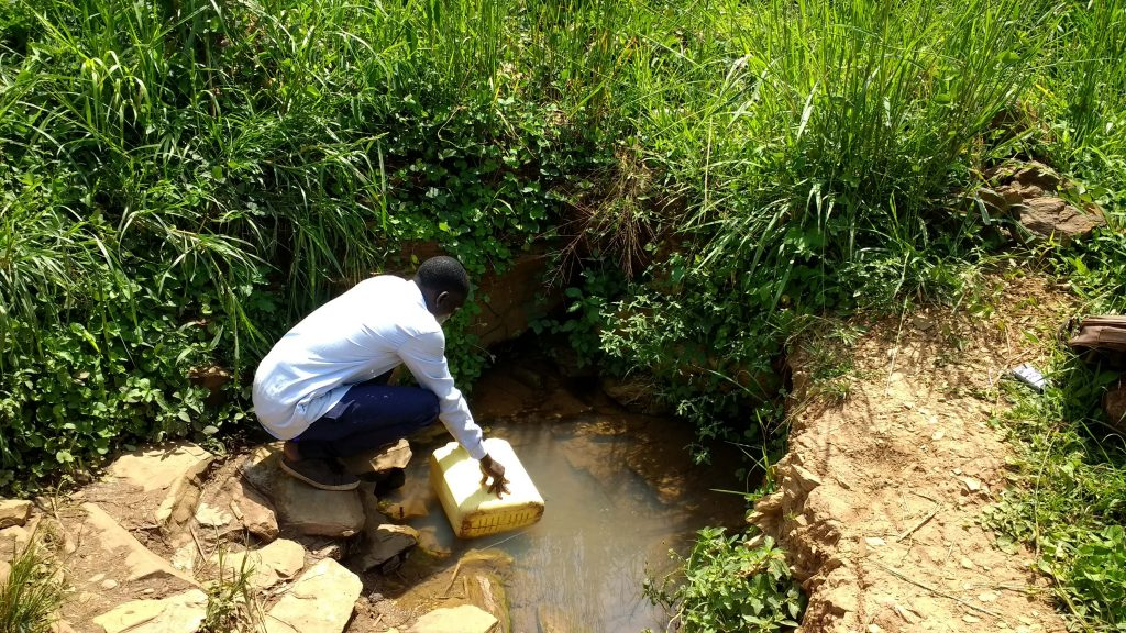The Water Project : 2-uganda6088-current-water-source