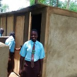 The Water Project: Friends Emanda Secondary School -  Sanitation Prefect Poses Next To The New Girl Latrines