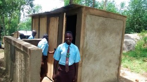 The Water Project:  Sanitation Prefect Poses Next To The New Girl Latrines