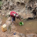 The Water Project: Kyumbe Community A -  Boy Fetching Water
