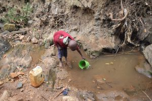 The Water Project:  Boy Fetching Water