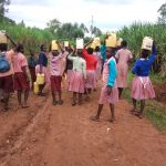 The Water Project: Irenji Primary School -  Carrying Water