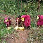 The Water Project: Shanjero Primary School -  Fetching Water
