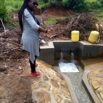 The Water Project: Timbito Community A -  Field Officer Christine Luvandwa At The Spring