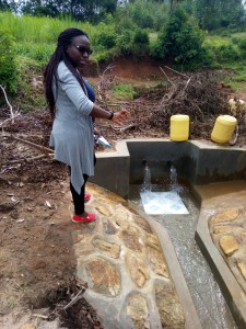 The Water Project : 5-kenya4847-field-officer-christine-luvandwa-at-the-spring