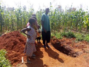 The Water Project:  Family Stands By A Recently Dug Pit For The New Platform