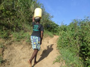 The Water Project:  Climbing The Hill From The Spring