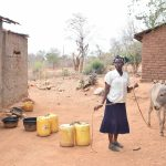 The Water Project: Karuli Community B -  Unloading The Donkey