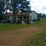 The Water Project: Mwitoti Secondary School -  Students Attending A Lesson Outside