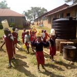 The Water Project: Bukura Primary School -  Students Delivering Water For Mixing Cement
