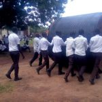 The Water Project: Mwitoti Secondary School -  Students Rolling The Broken Tank Away