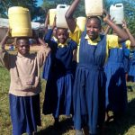 The Water Project: Gidagadi Primary School -  Carrying Water