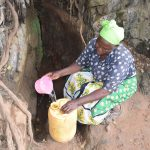 The Water Project: Kyumbe Community A -  Fetching Water