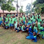 The Water Project: Musunji Primary School -  Students Carrying Stones