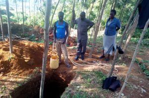 The Water Project:  Community Members Sinking A Pit For Latrines