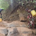 The Water Project: Kyumbe Community -  Carrying Water
