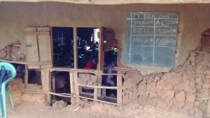 The Water Project:  Students In Class With Crumbling Walls