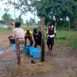 The Water Project: Mwitoti Secondary School -  Fetching Water From The Primary School
