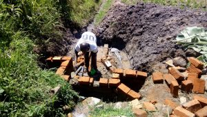 The Water Project : 9-kenya4848-placing-the-discharge-pipe