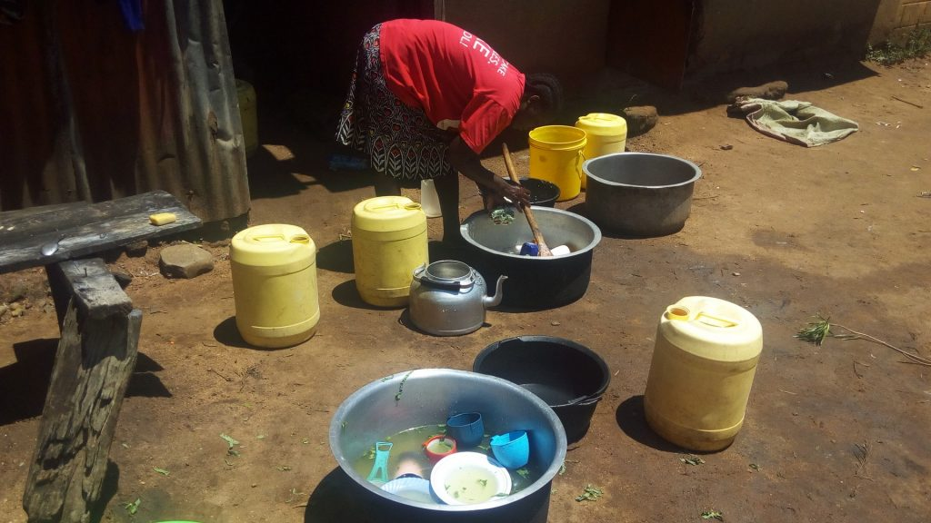 The Water Project : 10-kenya4689-cook-washing-utensils-at-kitchen