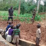 The Water Project: Ebuhando Community -  Backfilling