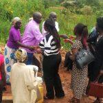 The Water Project: Futsi Fuvili Community, Futsi Fuvili Spring -  Community Members Saying Thank You To Staff