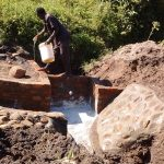 The Water Project: Shiamboko Community, Oluchinji Spring -  Curing Cement