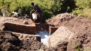 The Water Project : 11-kenya4732-curing-cement-2