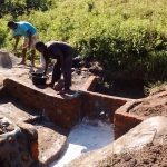The Water Project: Shiamboko Community, Oluchinji Spring -  Community Members Helping