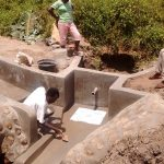 The Water Project: Shiamboko Community, Oluchinji Spring -  Plastering