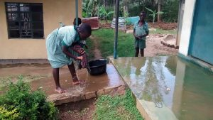 The Water Project:  Student Washing Floor