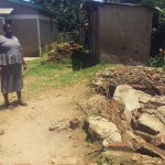 The Water Project: Shibale Primary School -  Headteacher Showing Us Demolished Latrines