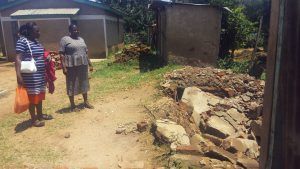 The Water Project:  Headteacher Showing Us Demolished Latrines