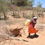 The Water Project: Katunguli Community -  Fetching Water